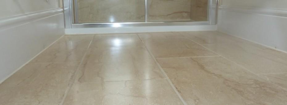 Vinyl floor low level shoot of a vinyl floor towards shower unit
