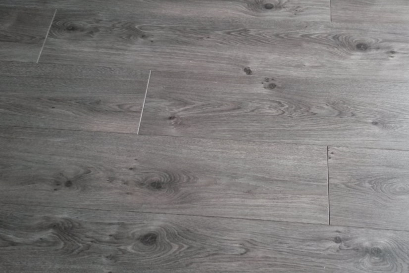 Garry Joy's installation of high quality dark wood laminate flooring showing view looking down